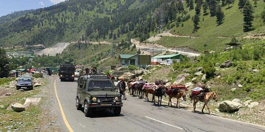 An Indian army convoy moves on the Srinagar- Ladakh highway at Gagangeer, north-east of Srinagar, Thursday, June 18, 2020. (Photo | AP)