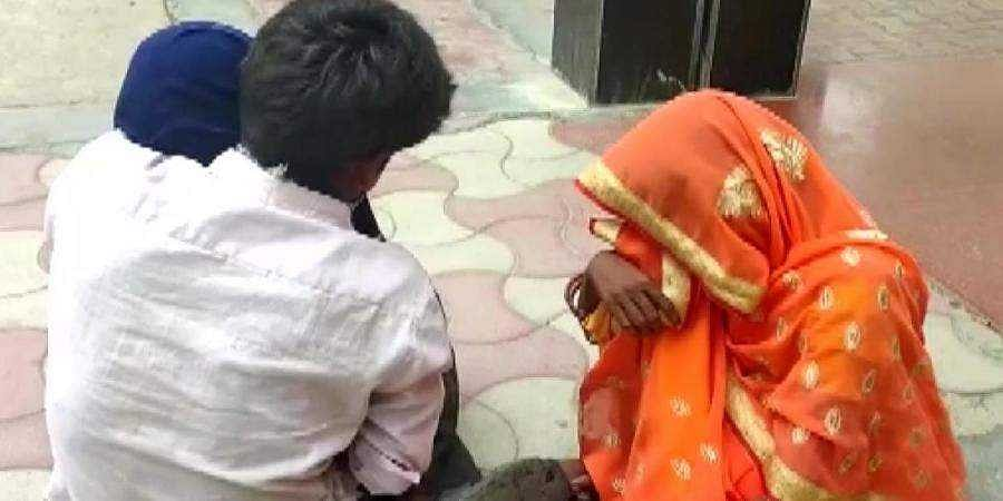 Premchand, a resident of Mishripur village in Kannauj district, is heard alleging in the video that no doctor saw his child.