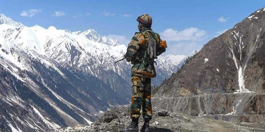 An army soldier stands guard at Zojila Pass situated at a height of 11 516 feet on the way to frontier region of Ladakh