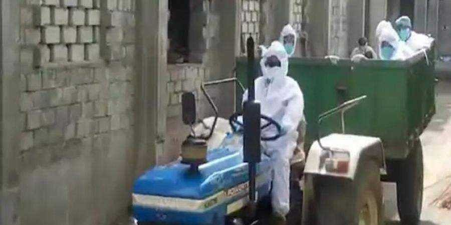 Video grab of a Telangana doctor driving a tractor to transport a coronavirus victim's body to the crematorium.