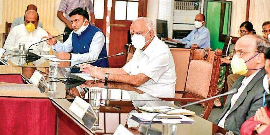 Chief Minister B S Yediyurappa holds a meeting with Medical Education Minister Dr K Sudhakar and experts on the Covid-19 situation, on Wednesday.