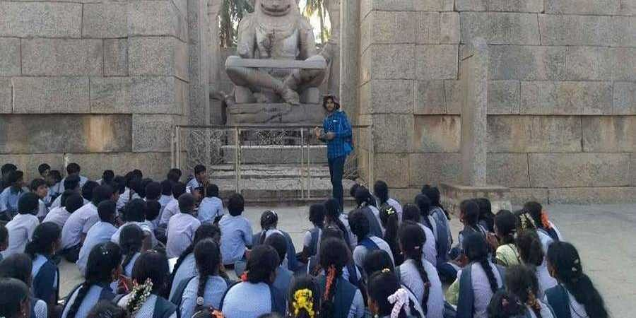 College students take a guided tour in Hampi