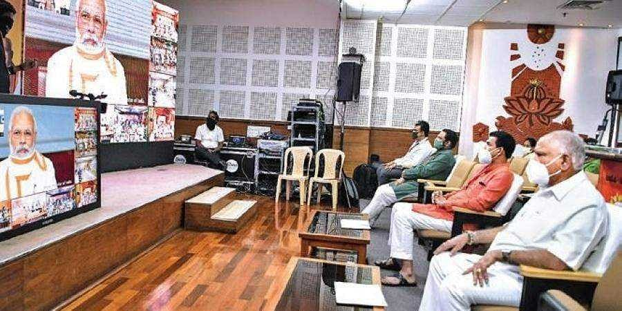 Chief Minister B S Yediyurappa with party leaders during the video-conference with Prime Minister Narendra Modi on Saturday