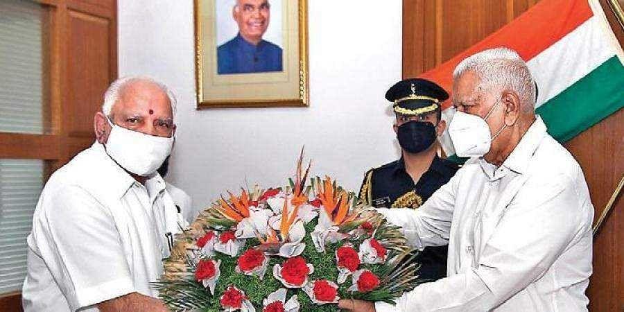 Chief Minister B S Yediyurappa meets Governor Vajubhai Vala at Raj Bhavan on Friday in Bengaluru
