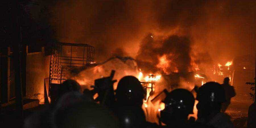 Police vehicles torched in front of DJ Halli police station in Bengaluru on Tuesday night.