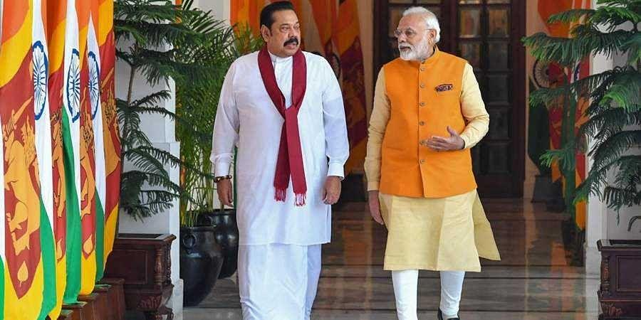 PM Modi with Sri lankan PM Mahinda Rajapaksa (File pic)