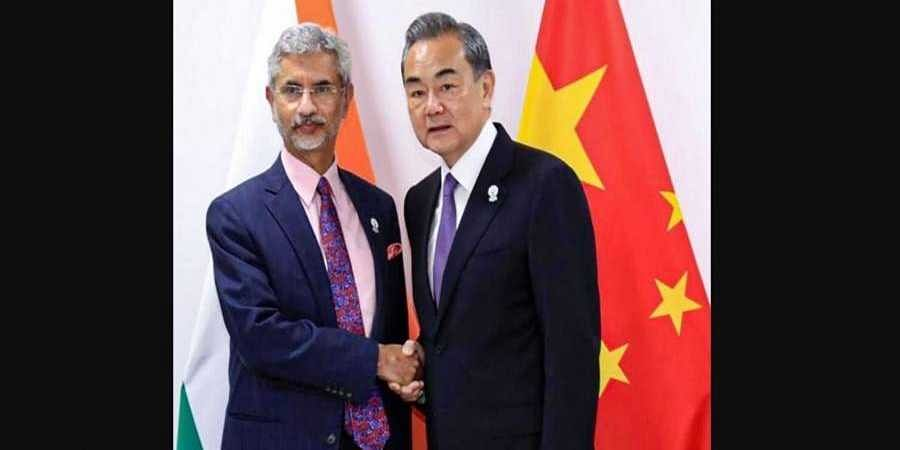External Affairs Minister S Jaishankar shakes hands with Chinese State Councilor and Foreign Minister Wang Yi during a meeting at ASEAN Thailand 2019.