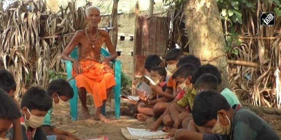 A screengrab of Nanda Prasty teaching the children. (Youtube/ANI News)
