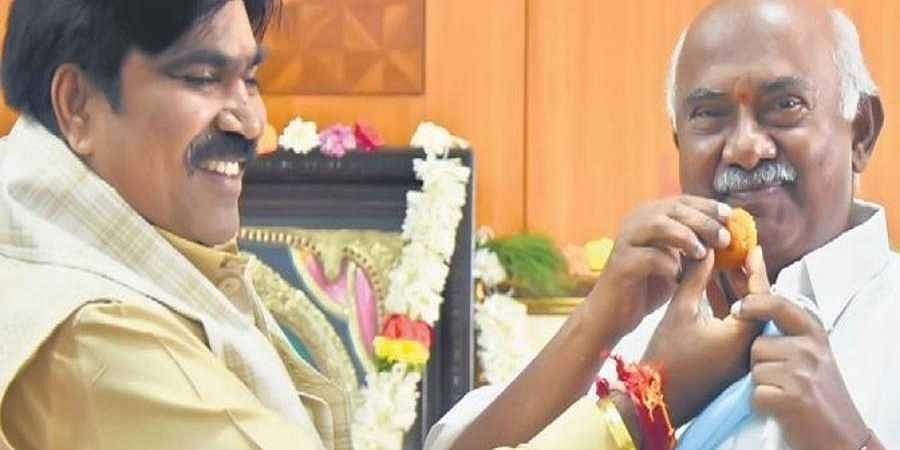 Newly-inducted minister R Shankar with MLC A H Vishwanath during a puja at the former's office in Vidhana Soudha on Monday