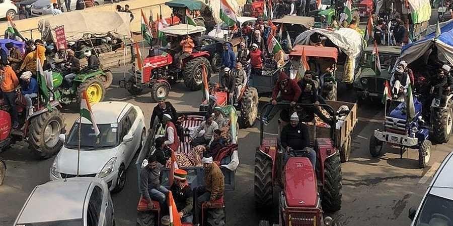 Farmers on tractors near Ghazipur border.