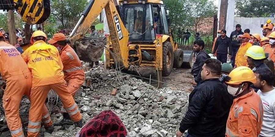 Rescue operation carried out by NDRF personnel after the complex roof of a crematorium collapsed due to heavy rain at Muradnagar in Ghaziabad Sunday Jan. 03 2021. (Photo | PTI)