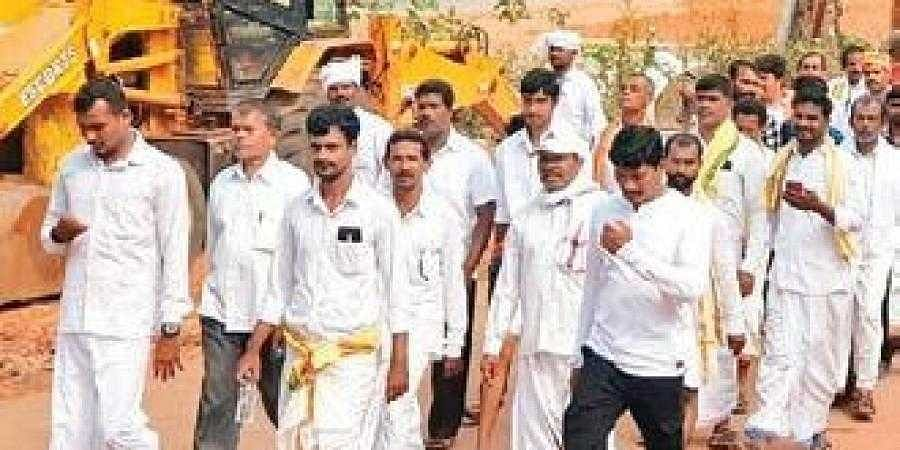 Members of backward communities taking out a rally in Bhatkal on Monday.