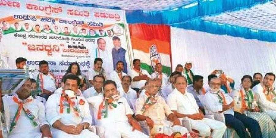 Former CM Siddaramaiah addressing party workers during the launch of the six-day Janadhwani padayatra in Padubidri, Udupi, on Monday