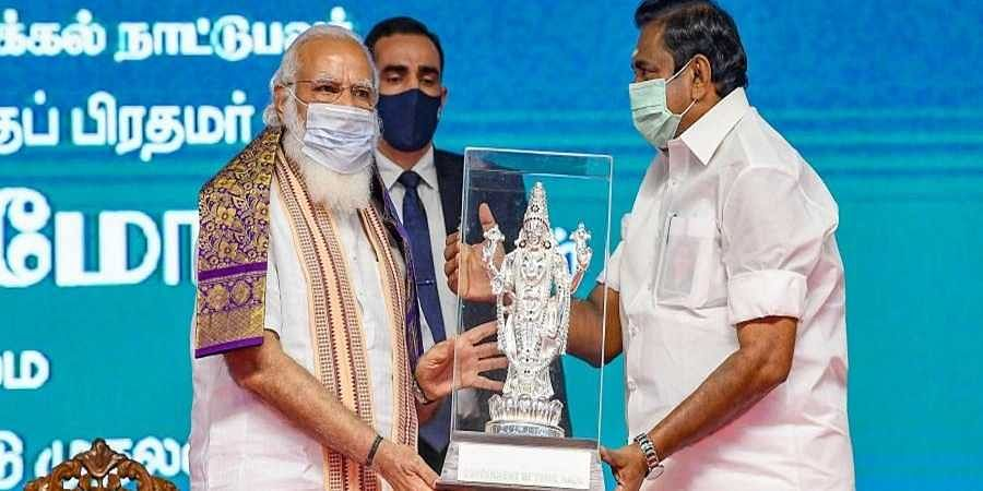 Prime Minister Narendra Modi being presented a memento by Chief Minister of Tamil Nadu Edappadi K. Palaniswami