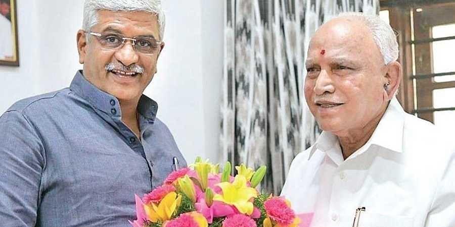 Union Minister of Jal Shakti Gajendra Singh Shekhawat greeting Chief Minister  B S Yediyurappa on the latter's birthday, in Bengaluru on Saturday