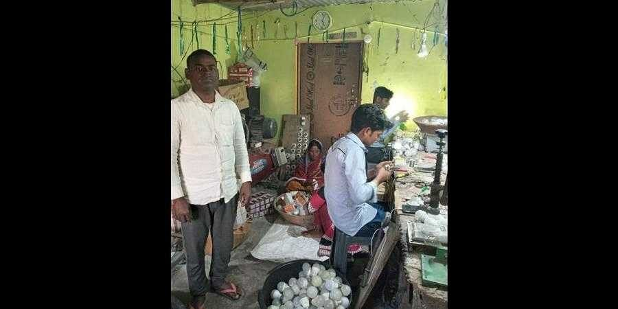 Pramod Baitha (L) at his LED bulb factory that he started at his home in West Champaran, Bihar (Photo | Express)