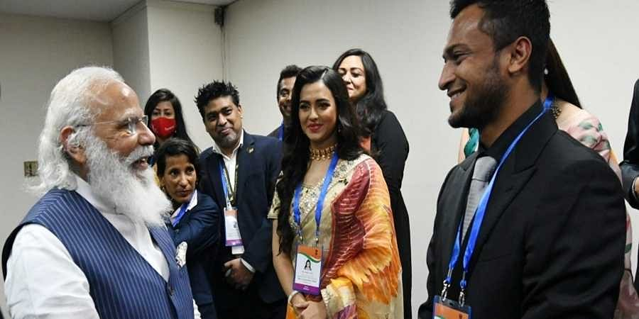 Prime Minister Narendra Modi with Bangladeshi cricketer Shakib Al Hasan