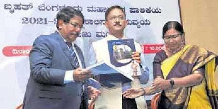 BBMP Commissioner N Manjunatha Prasad (left), Administrator Gaurav Gupta and Special Commissioner Tulasi Maddineni release the budget book on Saturday |