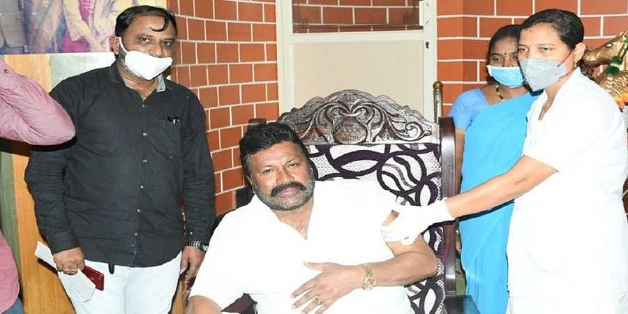 B C Patil taking COVID-19 vaccine at his house