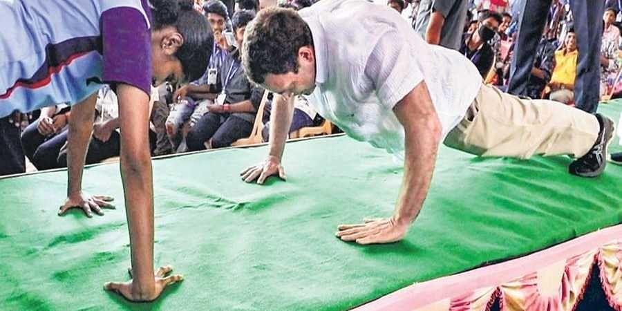 the Congress MP doing push-ups at a school in Kanniyakumari