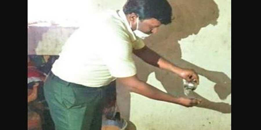 A video clip showing tahsildar Ashappa Pujar washing a tea cup at a hotel in Horogeri village in Gadag district