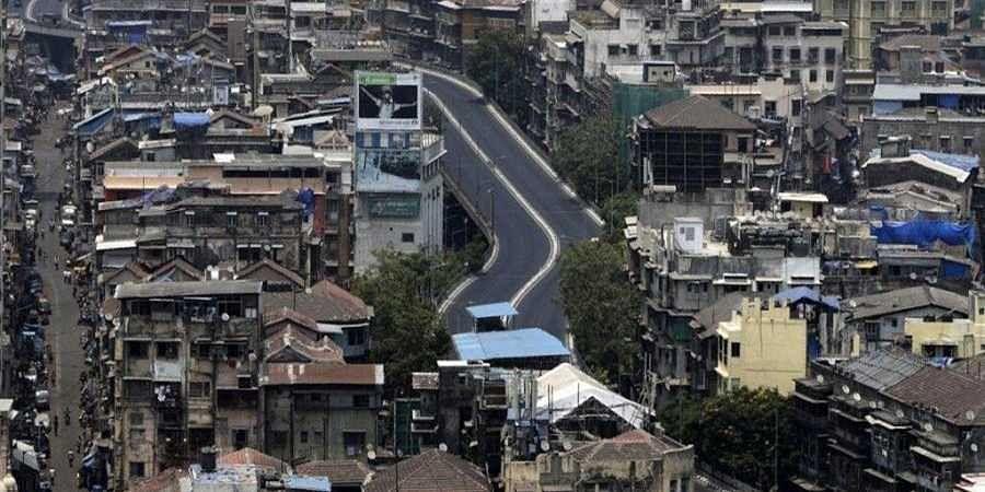 A street is seen deserted during weekend lockdown in Mumbai, India, Saturday, April 10, 2021.