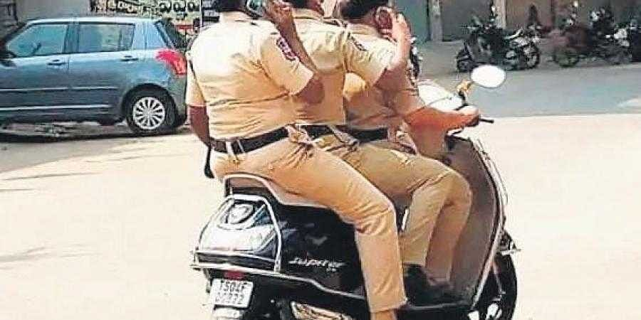 The three woman constables from Khammam who were fined for triple riding
