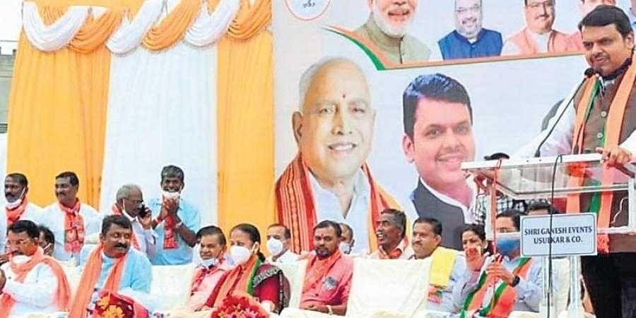 Former Maharashtra Chief Minister Devendra Fadnavis addresses people at Gokul Nagar in Hindalaga, Belagavi on Thursday