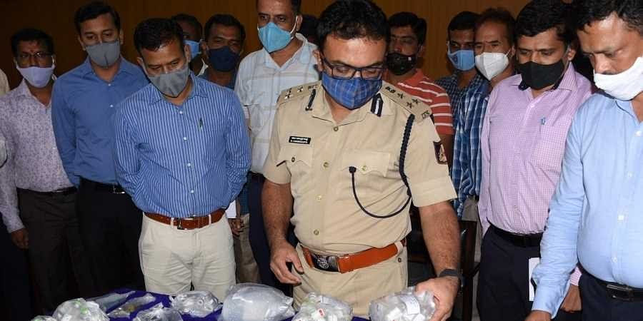commissioner Dr Chandragupta seen with fake Remdesivir vials