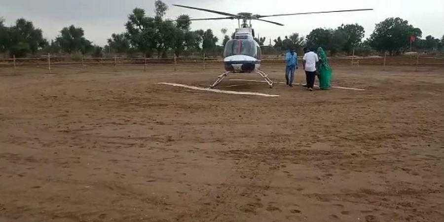 The chopper with baby Riya and her mother lands in the village