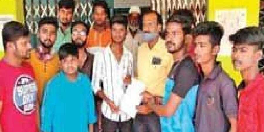 Residents, along with the boy, present a memorandum to the Block resource coordinator at the BEO's office in Pavagada on Wednesday