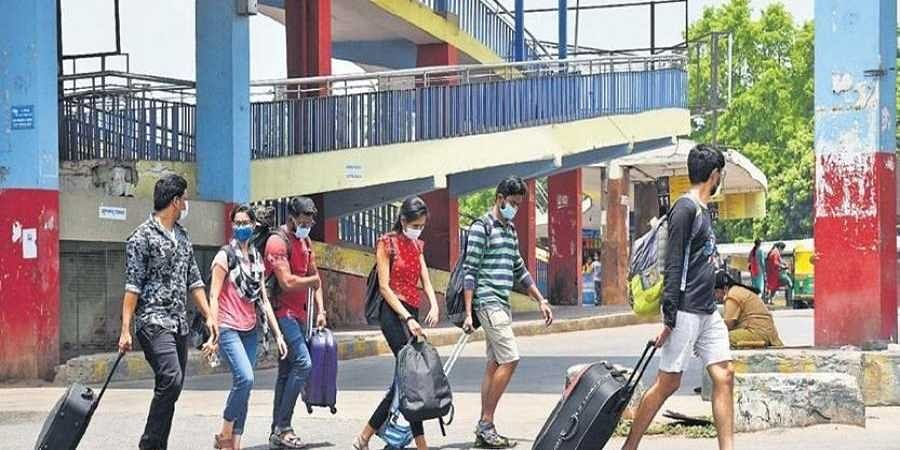 Majestic Bus Stand in Bengaluru wears a deserted look on the second day of the statewide transport strike on Thursday. Train passengers leave the bus stand