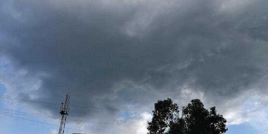 Dark clouds dominate the evening sky in Bengaluru on Friday
