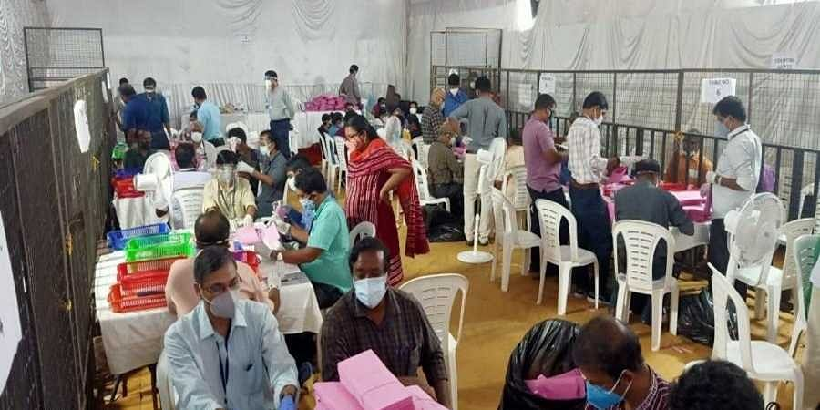 Officials at a counting room in Kerala.